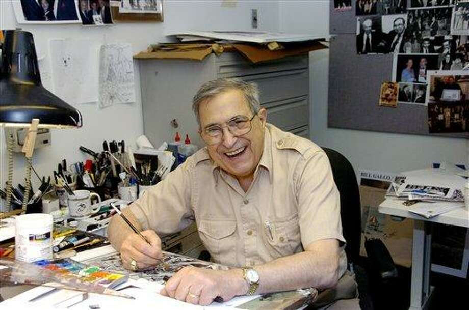 In this 2006 photo, Bill Gallo, a cartoonist and columnist for the New York Daily News, works at his drawing board in his office in New York. Gallo, whose playful characters appeared in the paper over seven decades, died Tuesday, May 10, 2011. He was 88.  (AP Photo/The Daily News, Thomas Monaster) Photo: ASSOCIATED PRESS / AP2011