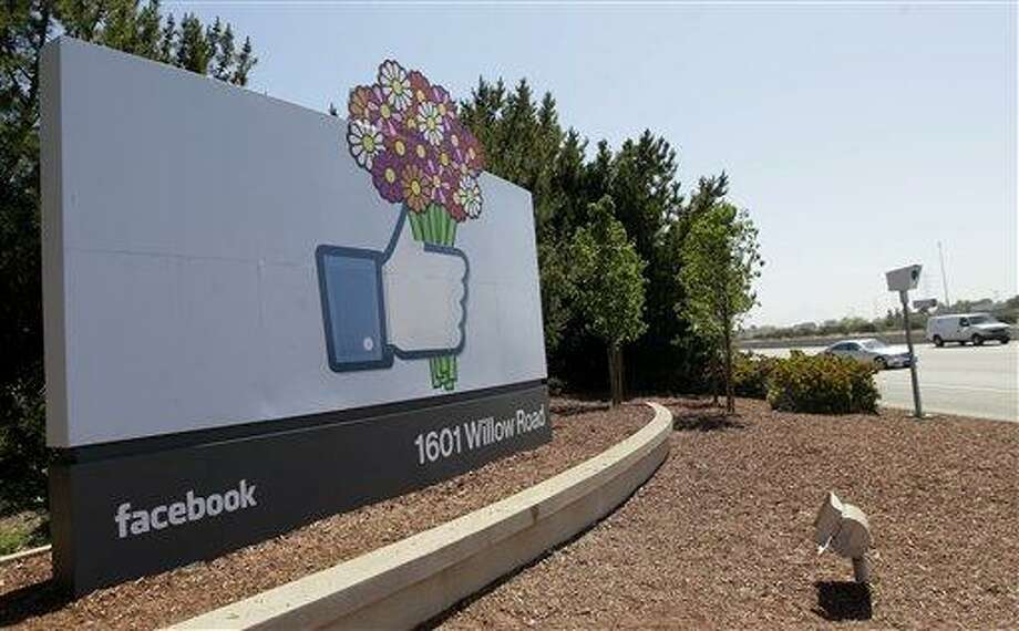 A sign is shown at the Facebook campus May 11 in Menlo Park, Calif. Half of Americans think Facebook is a passing fad, according to the results of an Associated Press-CNBC poll. And, in the run-up to the social network's initial public offering of stock, half of Americans also say the social network's asking price is too high. Associated Press Photo: AP / AP