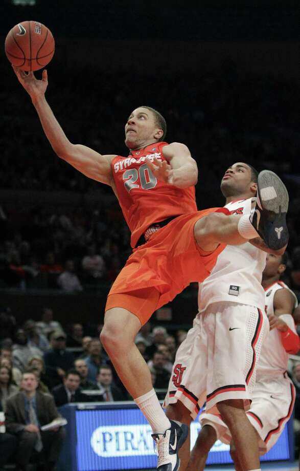 Syracuse Brandon Triche (20) drives past St. John's D.J. Kennedy (1) during the first half of an NCAA college basketball game, Wednesday, Jan. 12, 2011, in New York. (AP Photo/Frank Franklin II) Photo: ASSOCIATED PRESS / AP2011
