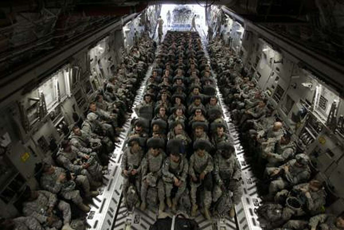 AP Photo/Maya Alleruzzo, FileIn this Nov. 30, 2010 file photo, members of 1st Brigade, 3rd Infantry Division, based at Fort Stewart, Ga., sit in the belly of a C-17 aircraft at Sather Air Base in Baghdad as they begin their journey home after a year in Iraq. President Barack Obama on Friday Oct. 21, 2011 declared an end to the Iraq war, one of the longest and most divisive conflicts in U.S. history, announcing that all American troops would be withdrawn from the country by year's end.