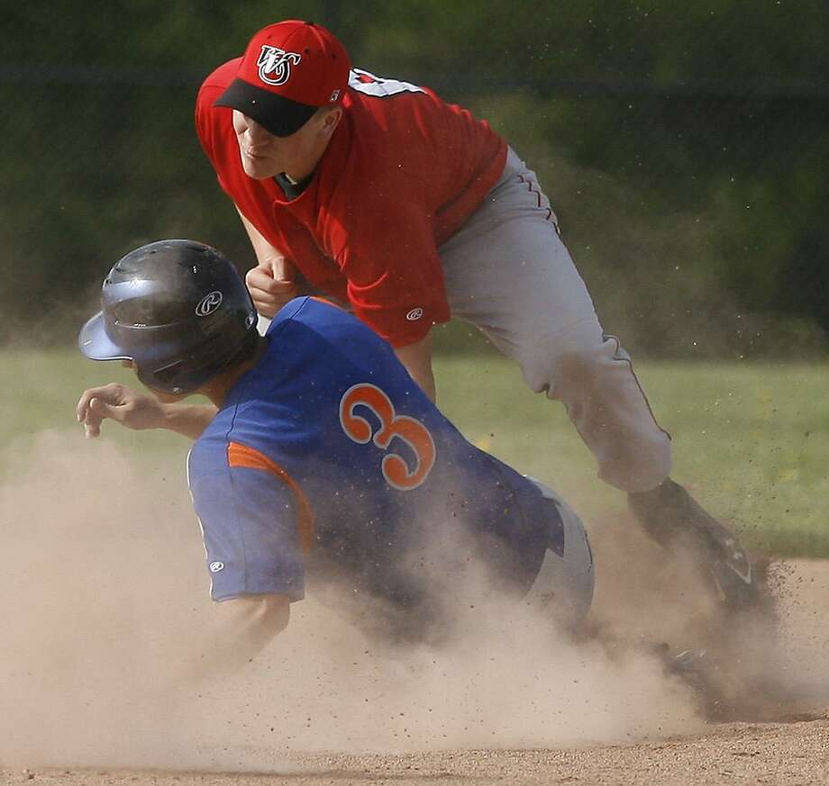 Dispatch Staff Photo by JOHN HAEGEROneida's Dylan VanDresar (3) is tagged out a second on the steal by VVS Cole Barbano (6) in the bottom of the first inning of play  on Thursday, May 12, 2011 in Oneida.