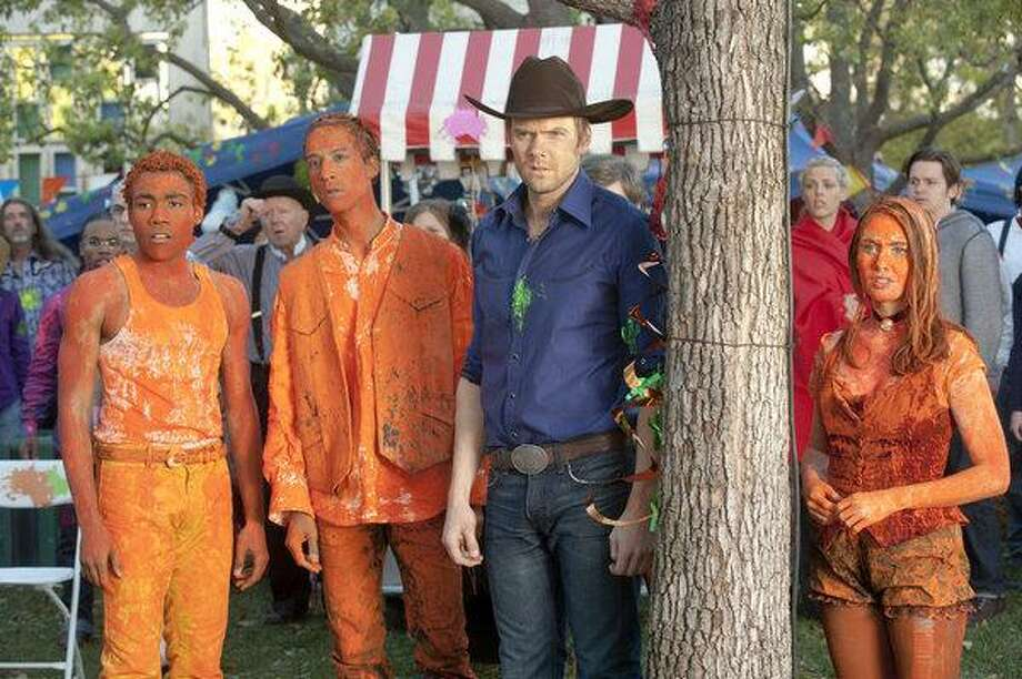 """Joel McHale, in hat, and his """"Community"""" castmates in the episode """"For a Few Paintballs or More."""" Photo: Lewis Jacobs/NBC / © NBCUniversal, Inc."""