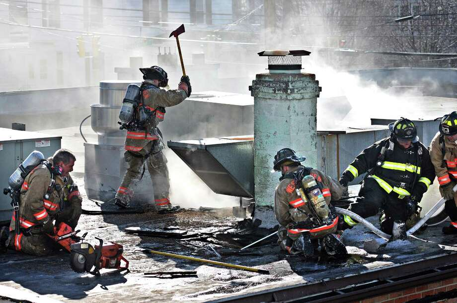 West Haven-- West Haven firefighters battle a two-alarm blaze on the roof of the iD Brazil Churrascaria & Restaurant at 241 Elm Street in West Haven. Workers had been doing renovations at the eatery when a fire broke out that spread to the roof. Peter Casolino/New Haven Register01/18/12