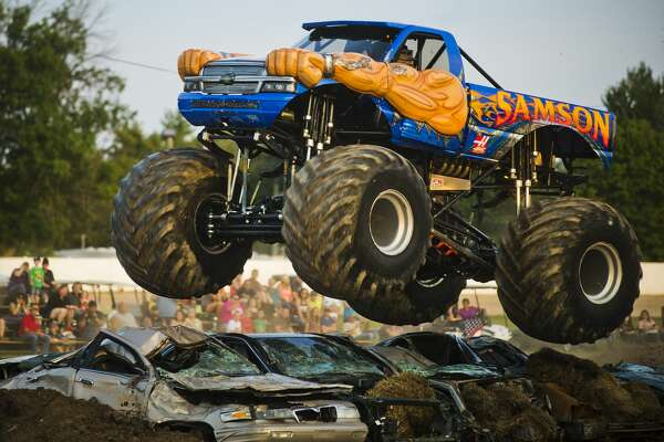 Rick Steffens of Ohio becomes airborne as he races his monster truck, Samson, during a monster truck rally on Wednesday, August 16, 2017 at the Midland County Fairgrounds.