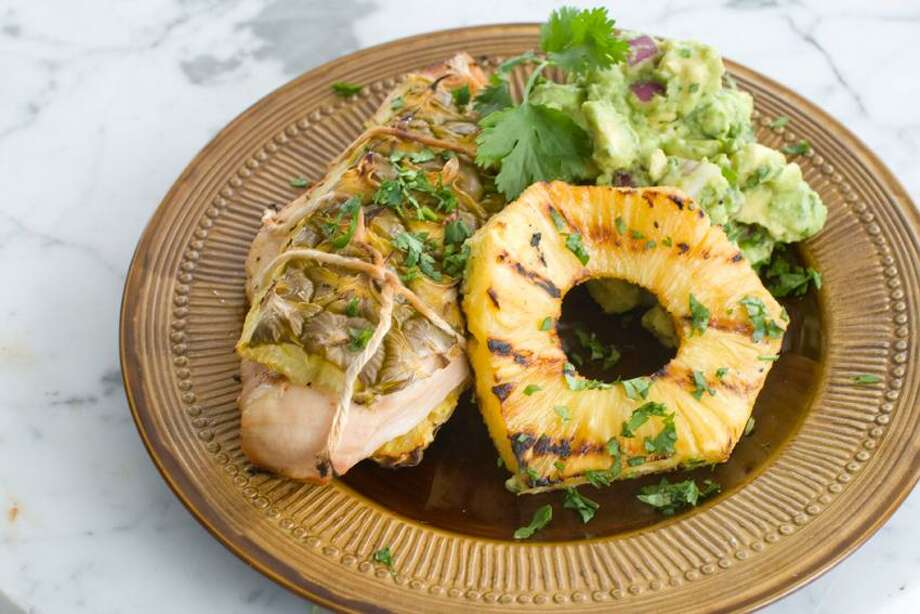 Matthew Mead/Associated Press photo: Pineapple Bark Chicken With Grilled Pineapple Guacamole Photo: AP / FR170582