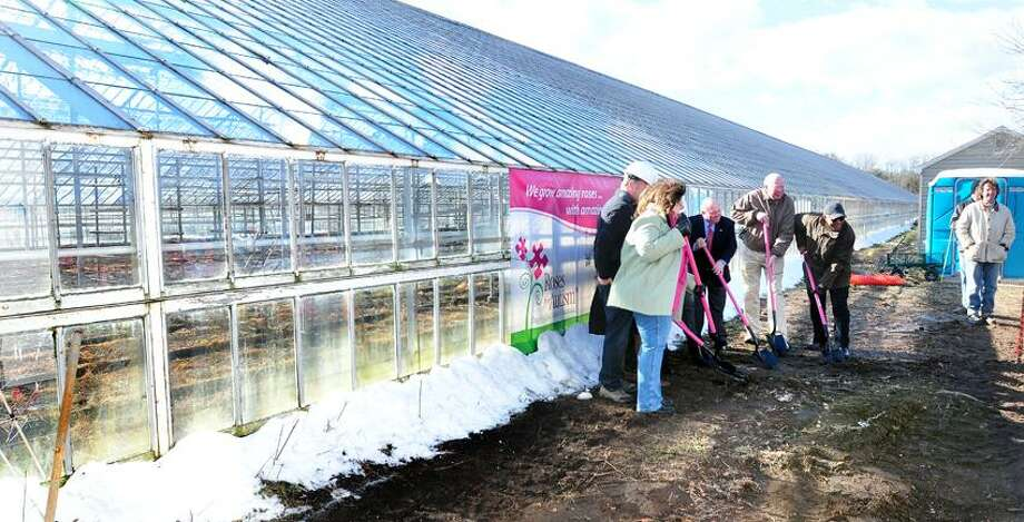 A ground-breaking ceremony for the Roses for Autism retail space is held Wednesday at Pinchbeck's Rose Farm in Guilford. (Arnold Gold/Register)