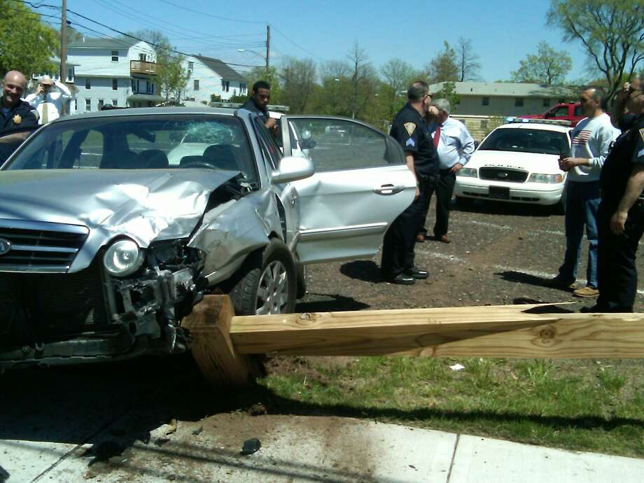 A high speed chase that started in New Haven ended in a crash by the town beach at Coe Avenue in East Haven.    Photo by William Kaempffer