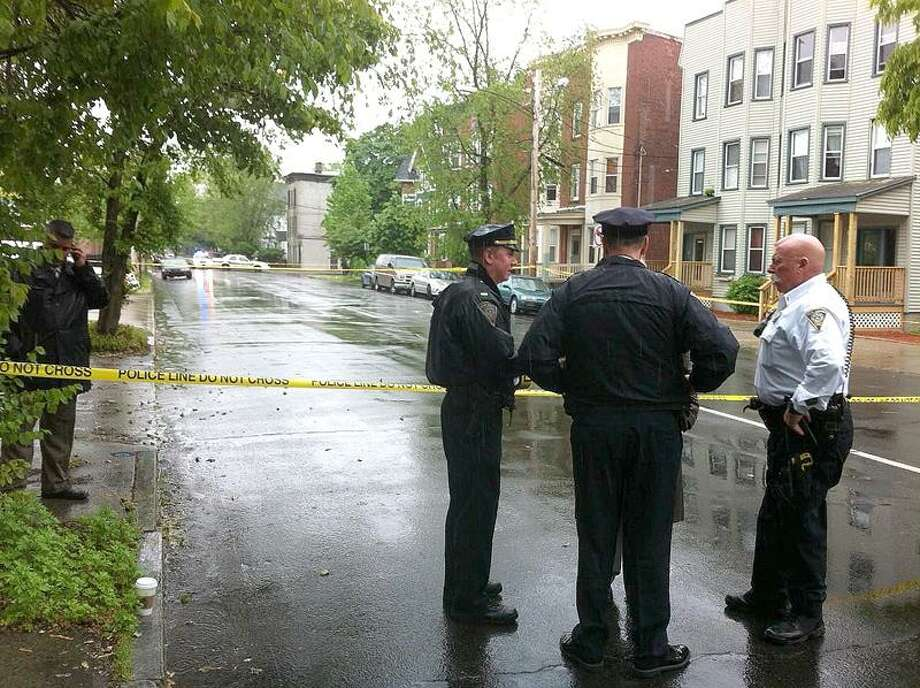 Police at the scene of a shooting Tuesday in New Haven. William Kaempffer/Register