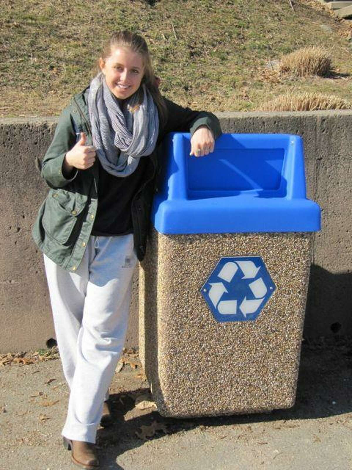 Hopkins student Sonia Lombroso with an outdoor recycling bin. Contributed photo.