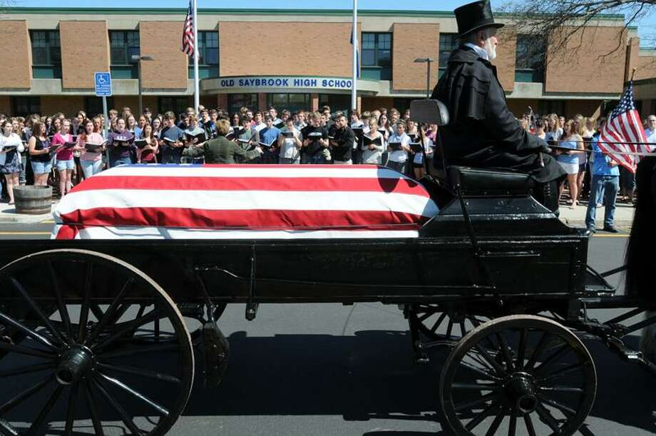 A caisson carrying the remains of long-missing soldier Primo Carnabuci stops by Old Saybrook High School, where the entire student body sang God Bless America. Mara Lavitt/Register
