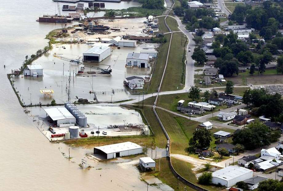 Buildings outside of levee protection take on floodwater in Morgan City, La. Associated Press Photo: AP / AP