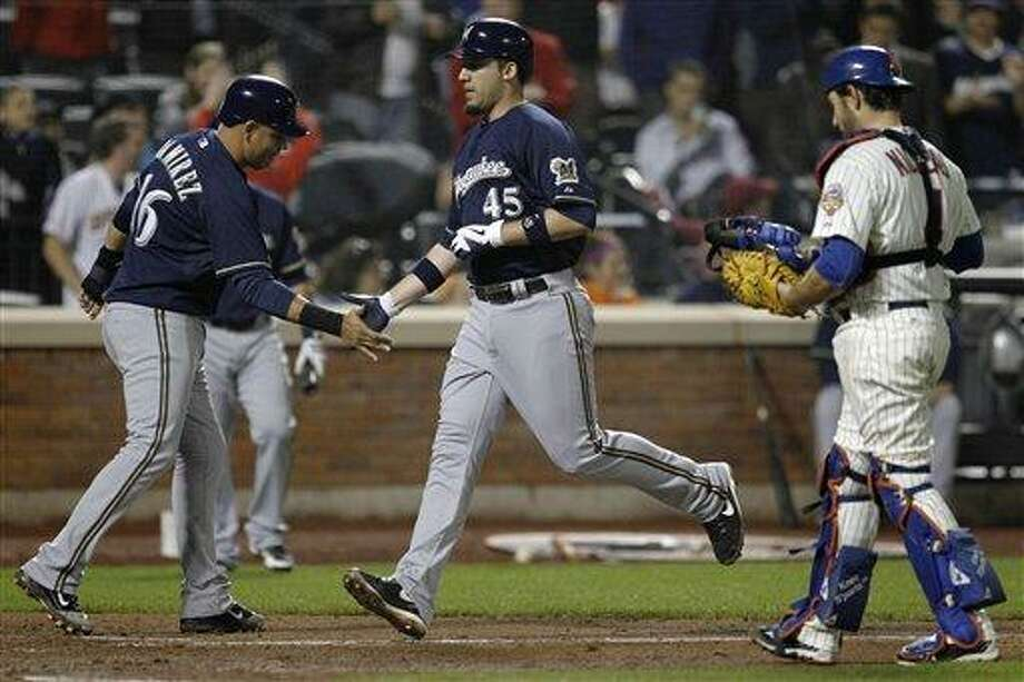 New York Mets catcher Mike Nickeas walks back to the plate as Milwaukee Brewers Aramis Ramirez, left,  greets Travis Ishikawa (45) after Ishikawa hit a three-run home run during the sixth inning of their baseball game at Citi Field in New York, Tuesday, May 15, 2012. (AP Photo/Kathy Willens) Photo: AP / AP