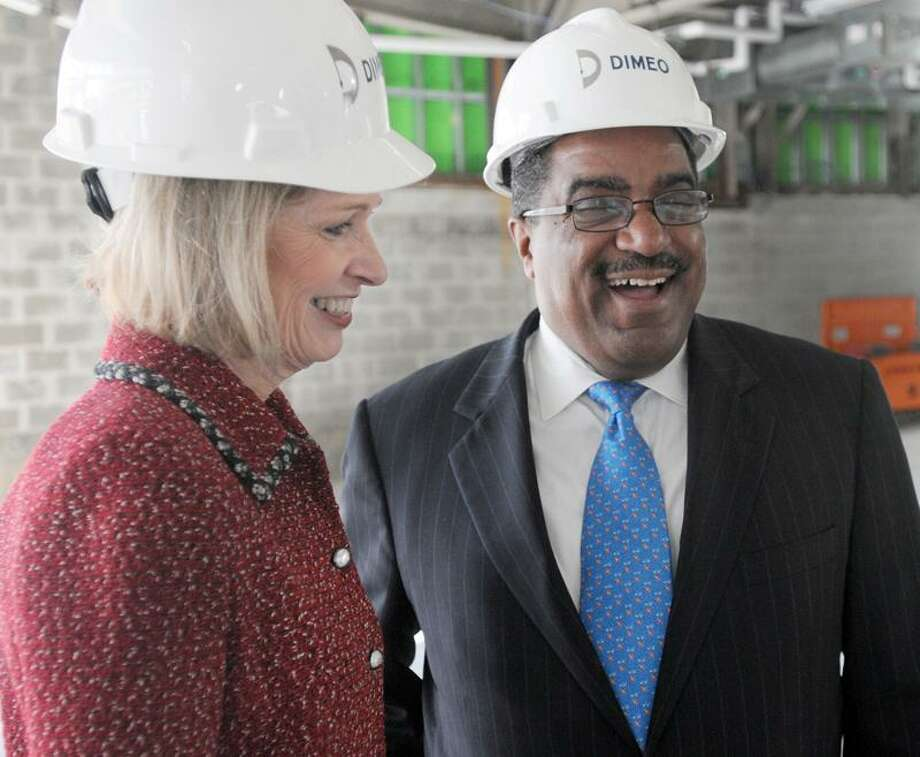 Yale-New Haven Hospital CEO and President Marna Borgstrom, left, and First Niagara Senior Vice President Paul McCraven at the Gateway Community College construction site in New Haven before announcing Thursday that the hospital and the bank will each give $500,000 to the Gateway Community College Foundation. Photo by Peter Hvizdak / New Haven Register / PETER HVIZDAK