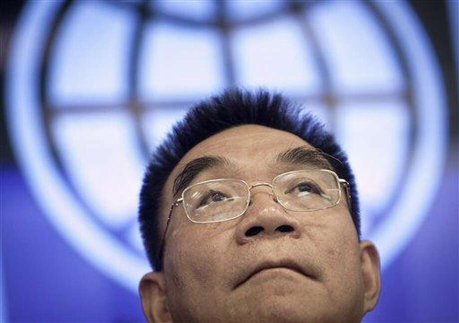 World Bank Chief Economist Justin Yifu Lin listens to a question from a reporter during a press conference on Global Economic Prospects at the World Bank Office in Beijing, China, Wednesday. The World Bank said a recession in Europe and weaker growth in India, Brazil and other developing countries will likely slow global economic growth.  Associated Press Photo: AP / AP