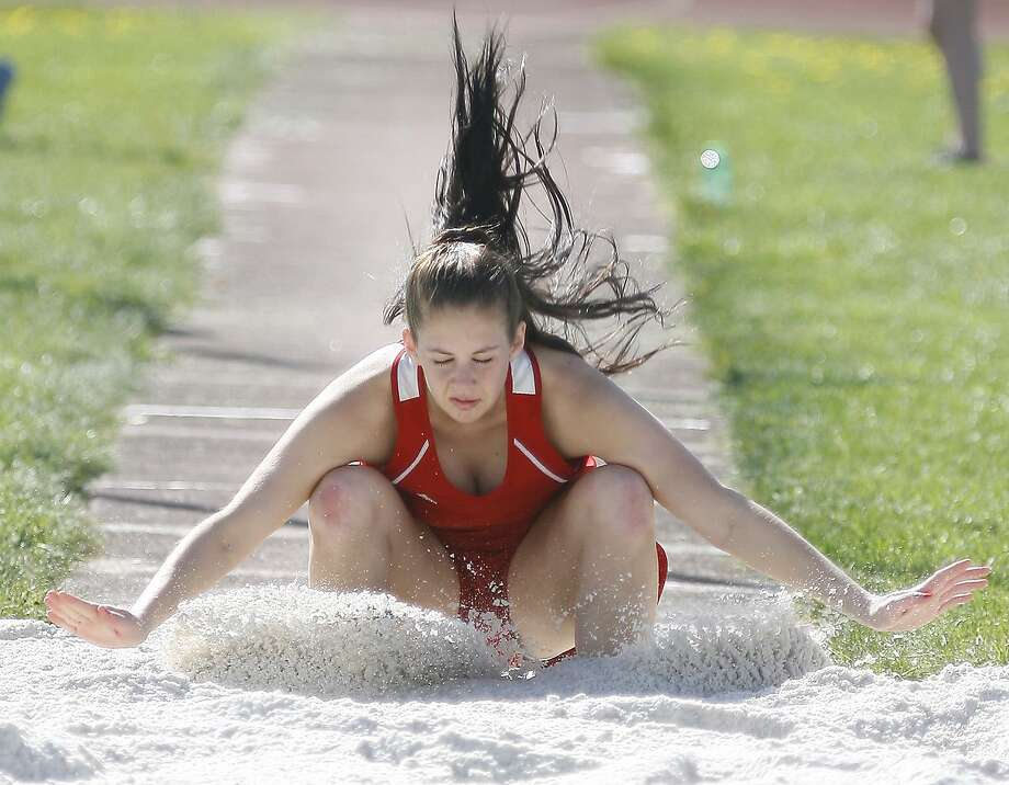 Dispatch Staff Photo by JOHN HAEGERVVS Alyssa Durant lands in the pit during the long jump  on Wednesday, May 11, 2011 in a meet against Oneida and UND at VVS.