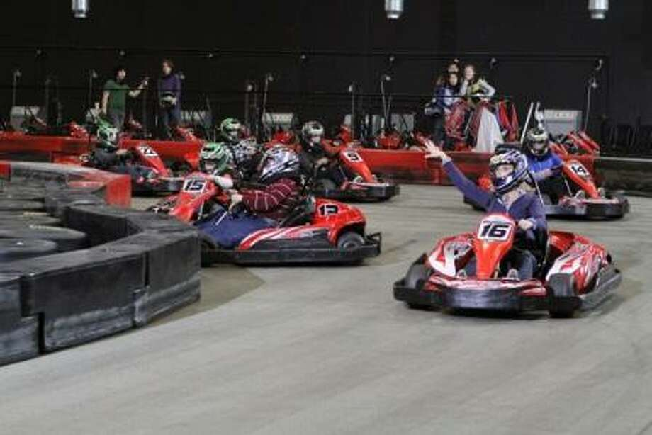 """Claire (Julie Bowen) finds success at the bumper car track on """"Modern Family"""" on ABC tonight."""