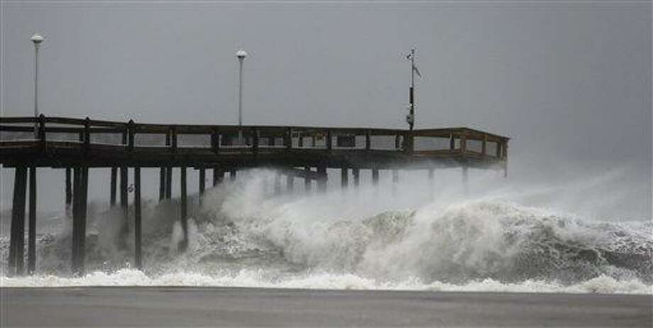 Waves crash into the Ocean City Fishing Pier as Hurricane Sandy bore down on the East Coast. Photo/Alex Brandon Photo: AP / AP