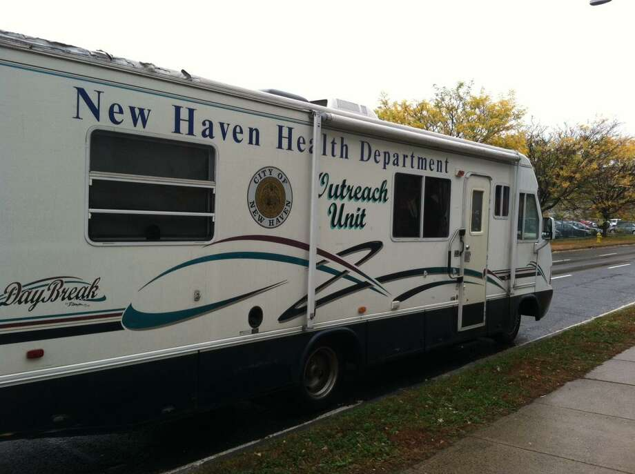 A mobile health unit waits outside Career High School in New Haven for residents displaced by Hurricane Sandy  Photo by Shahid Abdul-Karim