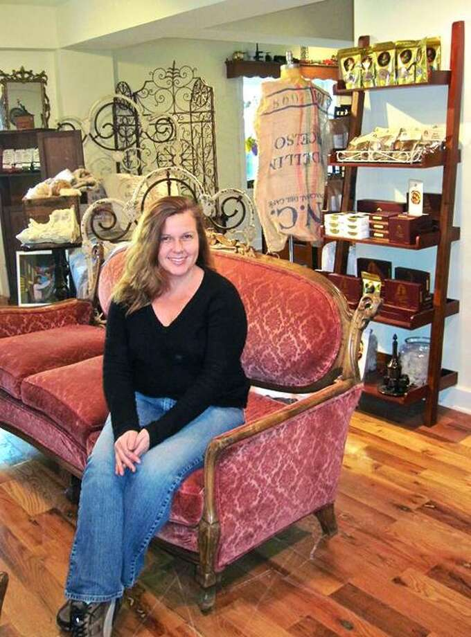 Kimberly Dulka sits in her new store, the All-American Valley General Store at 16 Bank St., Suite 140, in Seymour. (Patricia Villers/Register)
