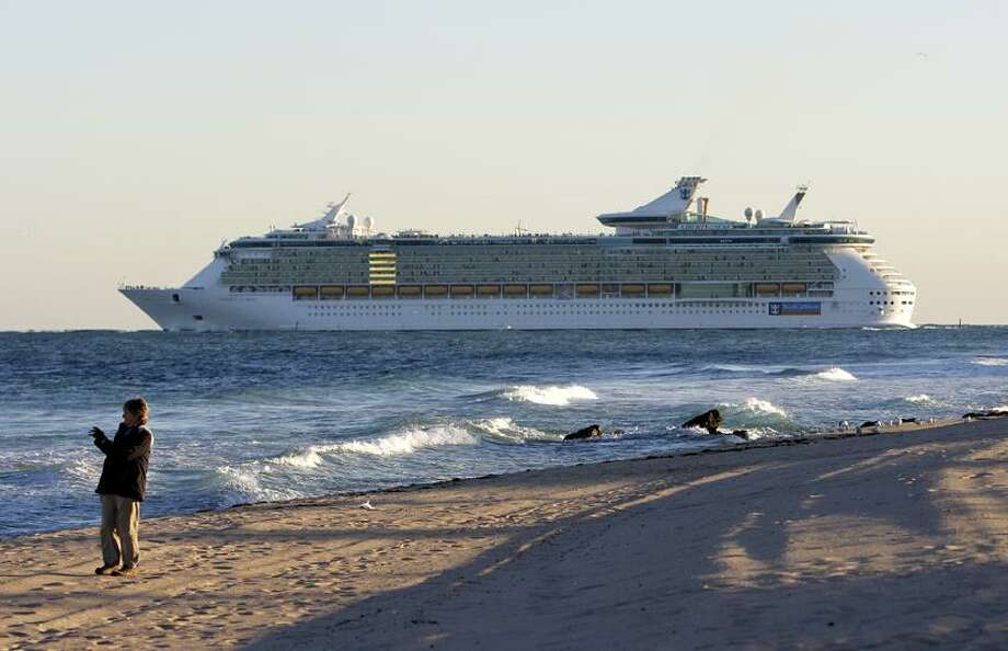 A Royal Caribbean cruise ship Liberty of the Seas heads out to sea Jan. 3 in Fort Lauderdale, Fla. Travel agents say the  Costa cruise ship disaster in Italy happened during prime cruise booking season and vacationers might be scared off. Associated Press Photo: AP / AP2012