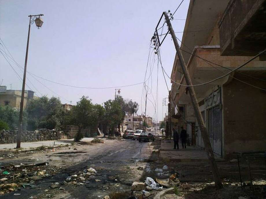An undated citizen journalist's photo made on a mobile phone and acquired by the Associated Press shows a damaged street in Daraa, Syria. Photo: AP / AP