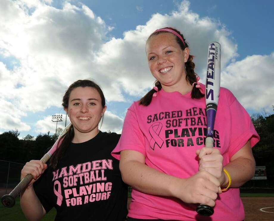 Hamden's Colleen Murphy left and Sacred Heart Academy's Katie Winkle of Orange right organized a fund-raiser to fight cancer for its softball game. Winkle had leukemia. Photo by Mara Lavitt/New Haven Register  5/11/11