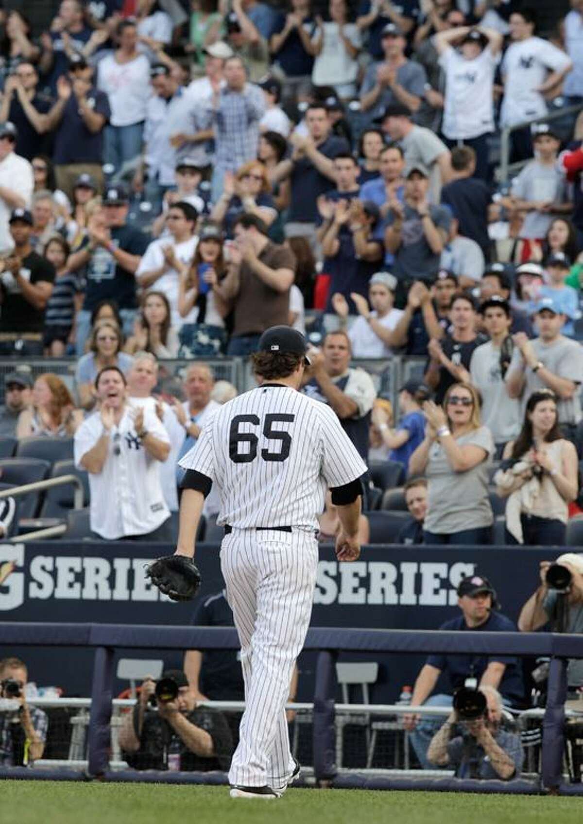New York Yankees starting pitcher Phil Hughes is cheered by fans as he leaves a baseball game against the Seattle Mariners in the eighth inning on Saturday, May 12, 2012 in New York. The Yankees won the game 6-2. (AP PhotoPeter Morgan)