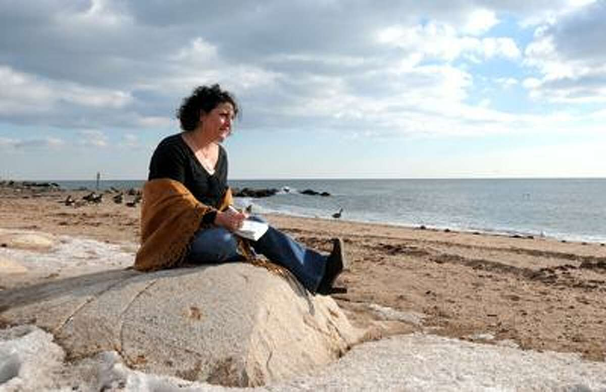 Mara Lavitt/Register, Susan Pettella loves to write in her journal at the East Haven Town Beach.