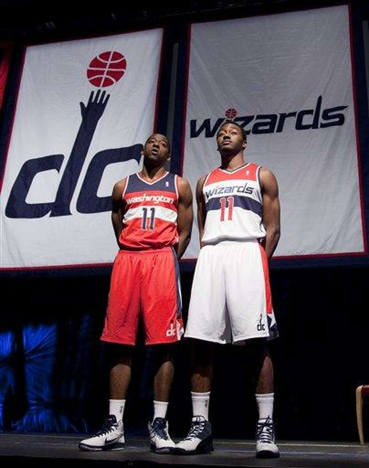 Washington Wizards basketball players Jordan Crawford, left, and John Wall show off the Wizards new uniforms on Tuesday, May 10, 2011, in Washington. (AP Photo/Evan Vucci)