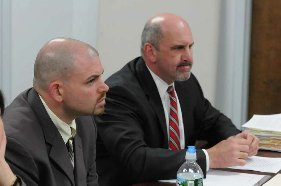 "Officer Timothy Brown, lef,t and his attorney, John ""Chip"" Walsh attend the disciplinary hearing. Mara Lavitt/Register"