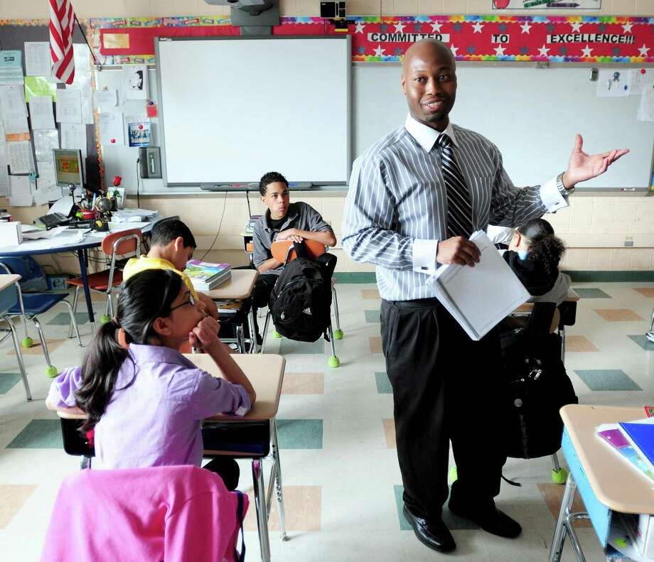 Ansonia teacher of the year Sherrod McNeill teaches sixth grade at Prendergast School in Ansonia on 5/9/2011.Photo by Arnold Gold/New Haven Register    AG0411C