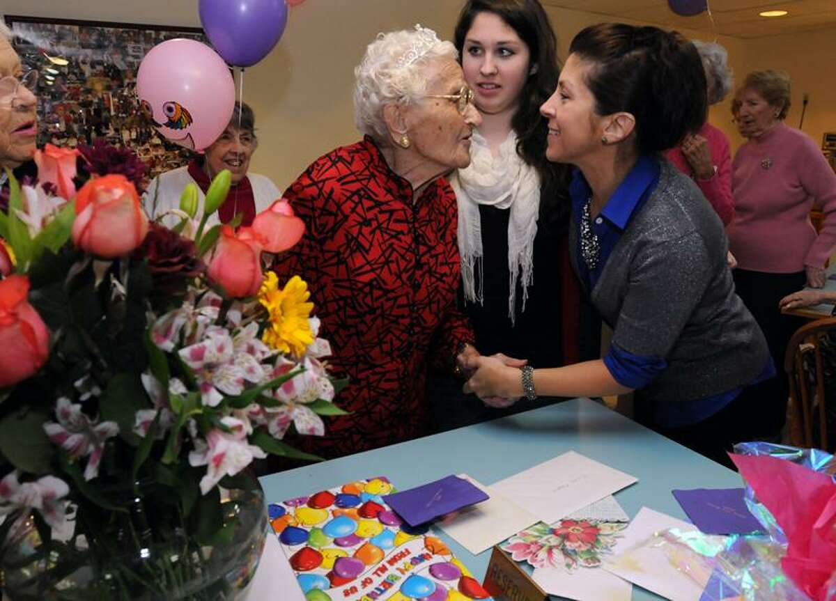 Cecilia Depgen turns 103 Monday and celebrated recently with fellow residents at Sliverbrook Estates in Orange. Family were also present including great-granddaughter Jane Depgen, center, and her mom Liz, right, both of Orange. Mara Lavitt/Register
