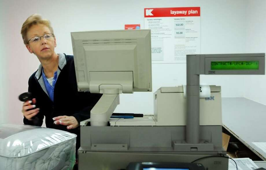 Janet Chrostowski, an employee at Kmart, scans a layaway purchase at the chain's Southbury store. Melanie Stengel/Register