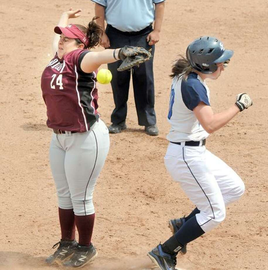Dewitt Family Field, Yale: NCAA Div. II East Super Regional softball game. Malloy over SCSU in 15 innings, 7-3. 4th inning: Malloy's Carla Campagna just can't get that ball as SCSU's Stacy Pouliot makes it safely across first. Mara Lavitt/New Haven Register5/11/12