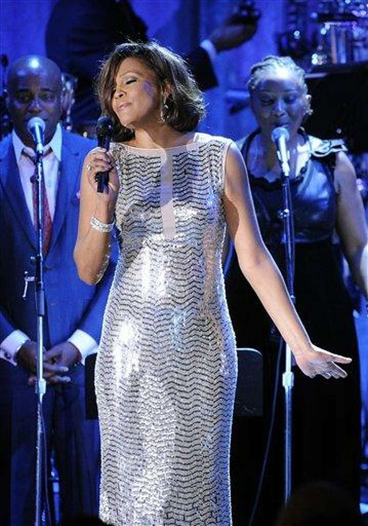 In this Feb. 13, 2011 file photo, singer Whitney Houston performs at the pre-Grammy gala & salute to industry icons with Clive Davis honoring David Geffen in Beverly Hills, Calif. (AP Photo/Mark J. Terrill, file)