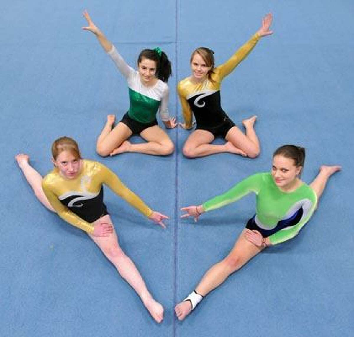 Madison--Hand/Guilford gymnasts clockwise from bottom left: Maia Smith, Alicia Rinaldi, Kim Megargee and Dana Colonese. Photo by Brad Horrigan/New Haven Register-01.06.11.