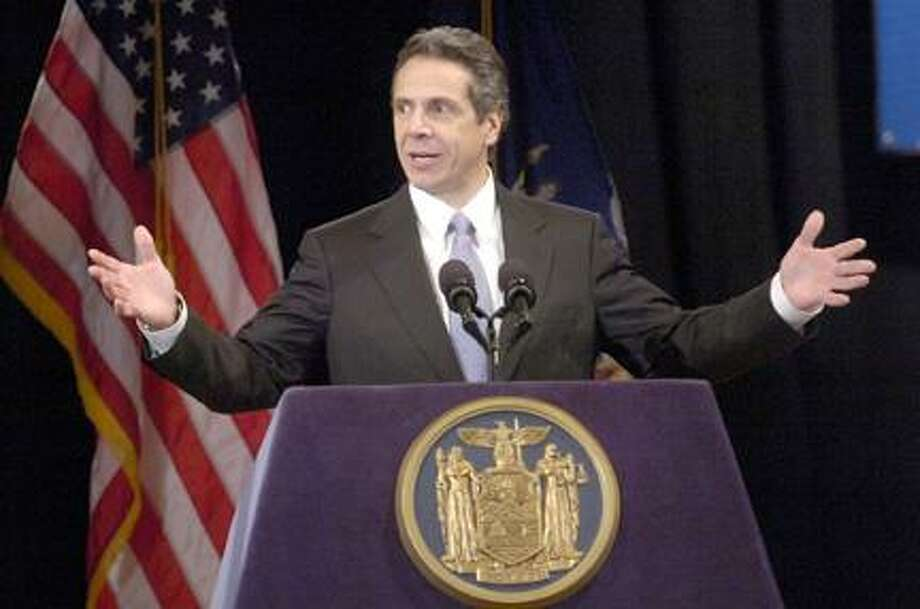 Journal Register News Service Photos by JIM CARRAS New York State Governor Andrew Cuomo calls on the Legislature to find solutions for the state's major problems. Photo: J.S.CARRAS / THE RECORD