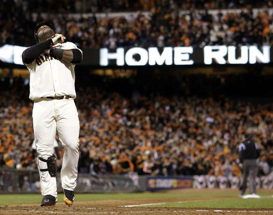 San Francisco Giants' Pablo Sandoval reacts at home after hitting his third home run of the game during the fifth inning of Game 1 of baseball's World Series against the Detroit Tigers Wednesday, Oct. 24, 2012, in San Francisco. (AP Photo/David J. Phillip) Photo: AP / AP2012