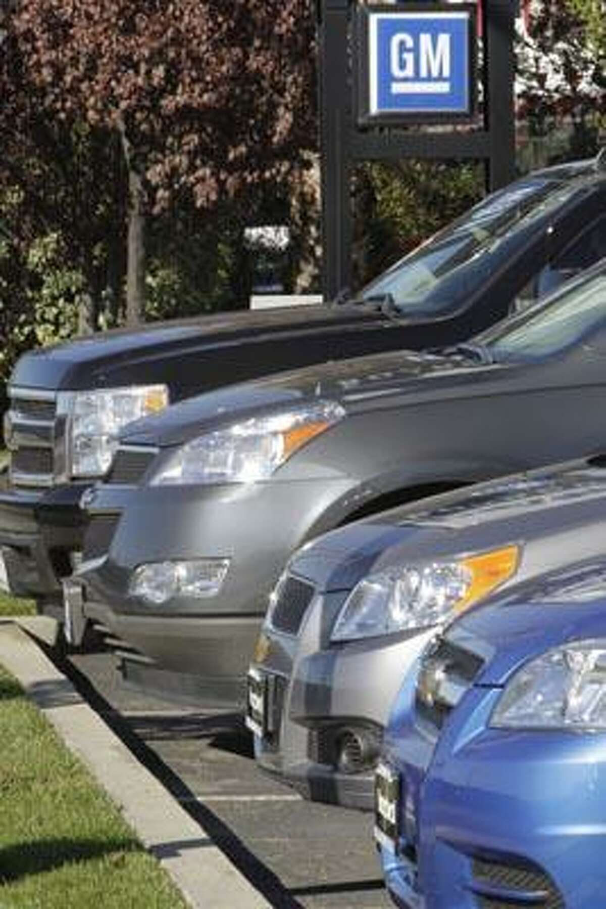 In this Nov. 29, 2010 photo, General Motors vehicles sit for sale at a dealership in Redwood City, Calif. General Motors says sales of cars and trucks in the U.S. rose 6.3 percent last year as a strong line-up of new models helped the company make a comeback from its 2009 bankruptcy. GM says it sold 2.2 million cars and trucks, even though it got rid of four brands to focus on Chevrolet, Buick, Cadillac and GMC. (AP Photo/Paul Sakuma)