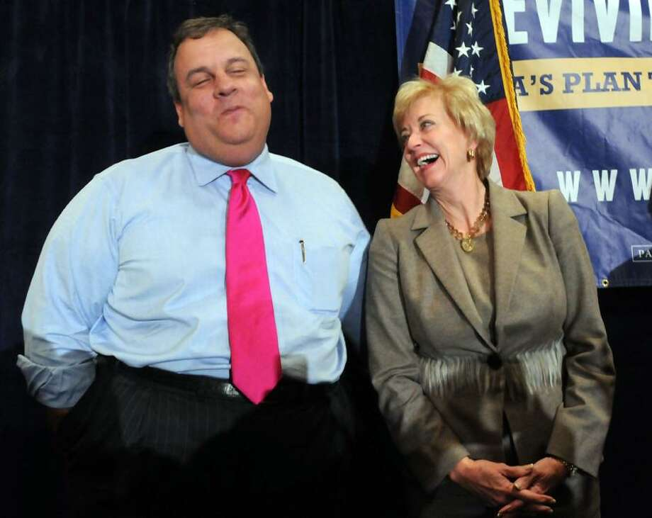 New Jersey Gov. Chris Christie made the rounds of rallies today including this one in Stamford with US Senate Republican candidate Linda McMahon. McMahon laughs after Christie removes his arm from her shoulder. Mara Lavitt/New Haven Register10/22/12
