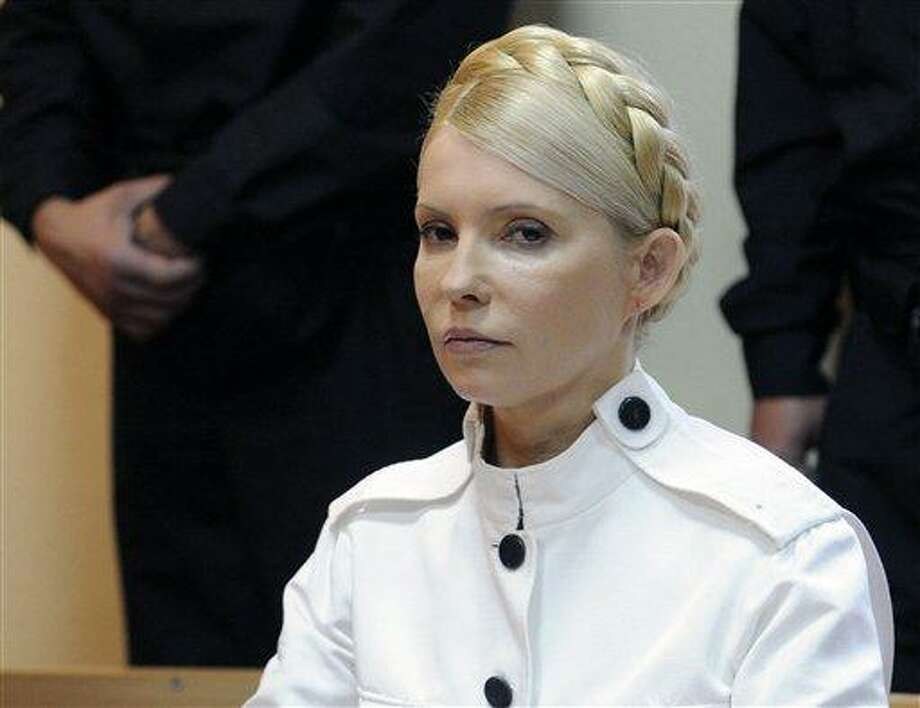In this 2011 file photo, former Ukrainian Prime Minister Yulia Tymoshenko appears during a trial hearing at the Pechersky District Court in Kiev, Ukraine. German doctors traveled to Ukraine on Friday to examine ailing ex-Prime Minister Yulia Tymoshenko at the prison where she is being held, but a Ukrainian official said she will not be allowed to leave the country for medical treatment. The 51-year-old Tymoshenko is on a hunger strike to protest the prison's alleged mistreatment of her as she serves a seven-year sentence on charges of abusing her powers when she was Ukraine's prime minister.  Associated Press Photo: AP / AP2011