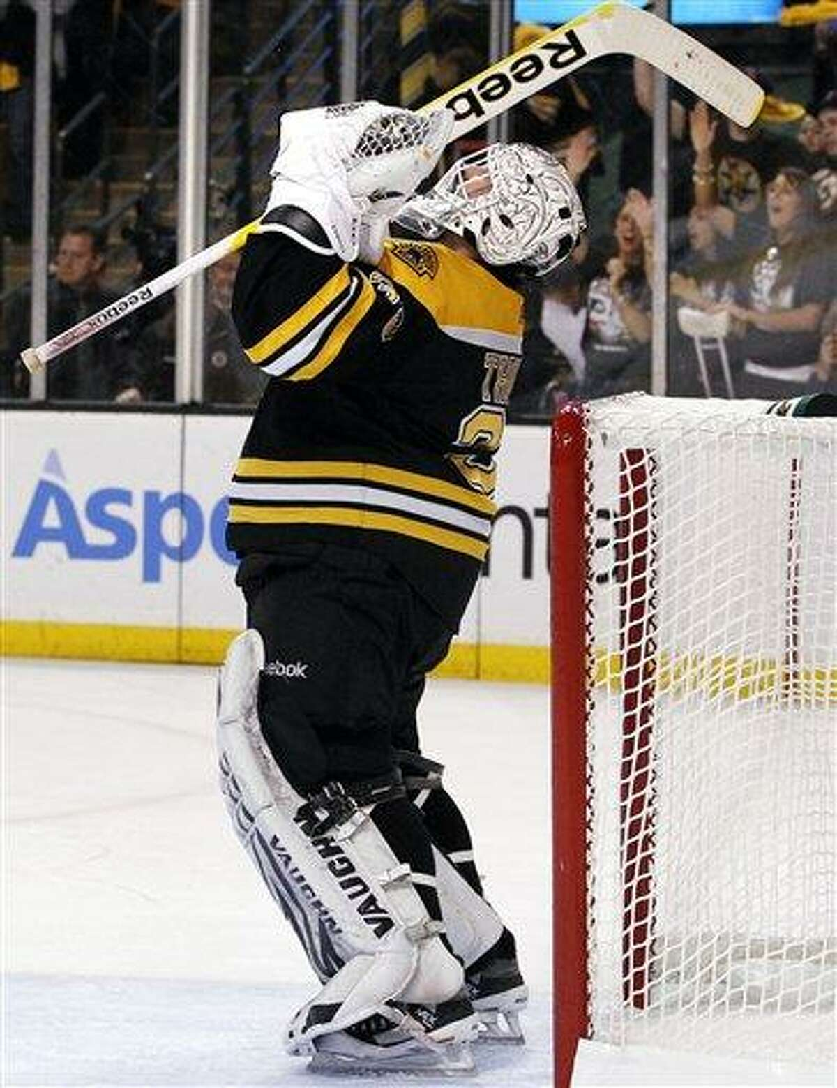 Boston Bruins goalie Tim Thomas celebrates after the Bruins defeated the Philadelphia Flyers 5-1 in Game 4 in a second-round NHL Stanley Cup hockey playoff series in Boston on Friday, May 6, 2011. The Bruins swept the series. (AP Photo/Elise Amendola)