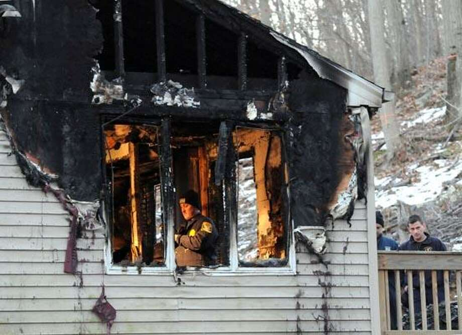 Fire investigators on the scene on Warner Rd. in East Haven. Photo by Mara Lavitt/New Haven Register1/3/11