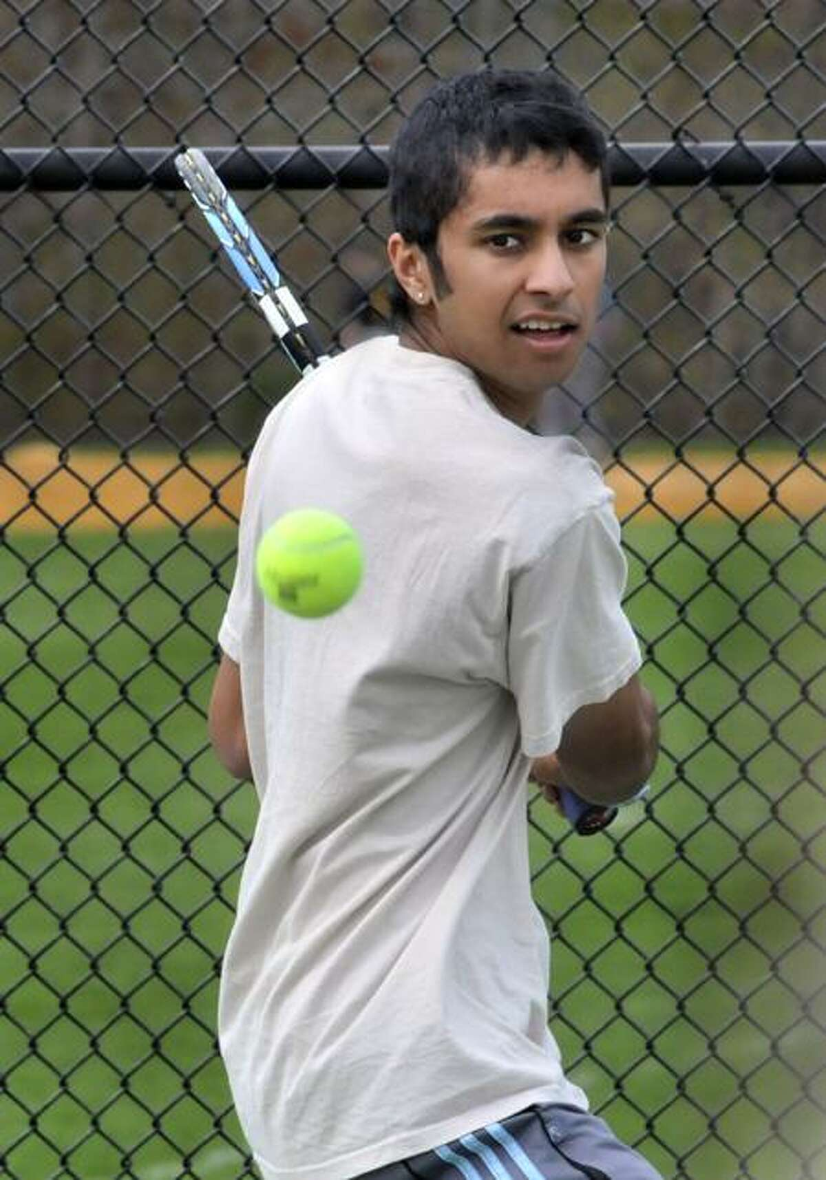 Amity co-captain Gaurav Bhat at tennis practice. Melanie Stengel/Register