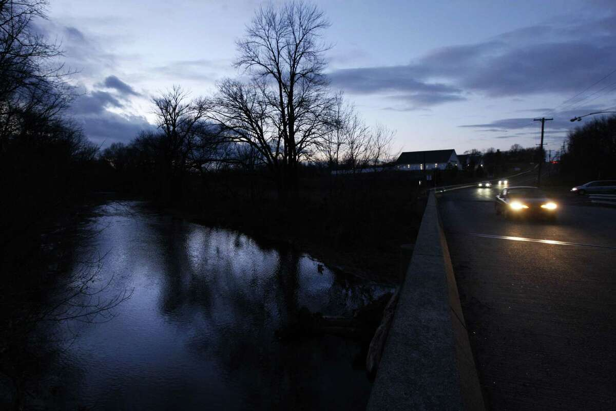 In this Dec. 15, 2010 photo, a car passes over the Neshaminy Creek after sunset in Chalfont Pa. According to state records treated drilling wastewater was discharged through the town sewage plant into the Neshaminy Creek. The natural gas boom gripping parts of the U.S. has a nasty byproduct: wastewater so salty, and so polluted with metals like barium and strontium, most states require drillers to get rid of the stuff by injecting it down shafts thousands of feet deep. Not in Pennsylvania, one of the states at the center of the gas rush. There, the liquid that gushes from gas wells is only partially treated for substances that could be environmentally harmful, then dumped into rivers and streams from which communities get their drinking water. (AP Photo/Matt Rourke)