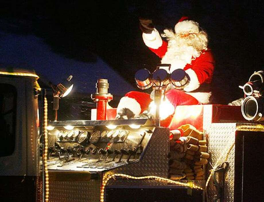 Dispatch Staff Photo by JOHN HAEGER (Twitter.com/OneidaPhoto) Santa waves from atop a Sherrill-Kenwood fire truck as he makes his way through the City of Sherrill last year. Santa will make an early visit to Sherrill this year on Saturday.