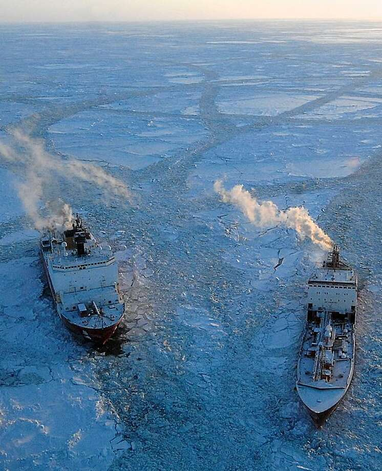 In this photo provided by the US Coast Guard, the cutter Healy, left, breaks ice around the Russian tanker Renda in the Bering Sea Tuesday, 97 miles south of Nome, Alaska. The two vessels departed Dutch Harbor for Nome on Jan. 3 to deliver more than 1.3 million gallons of petroleum products. Associated Press Photo: ASSOCIATED PRESS / AP2012