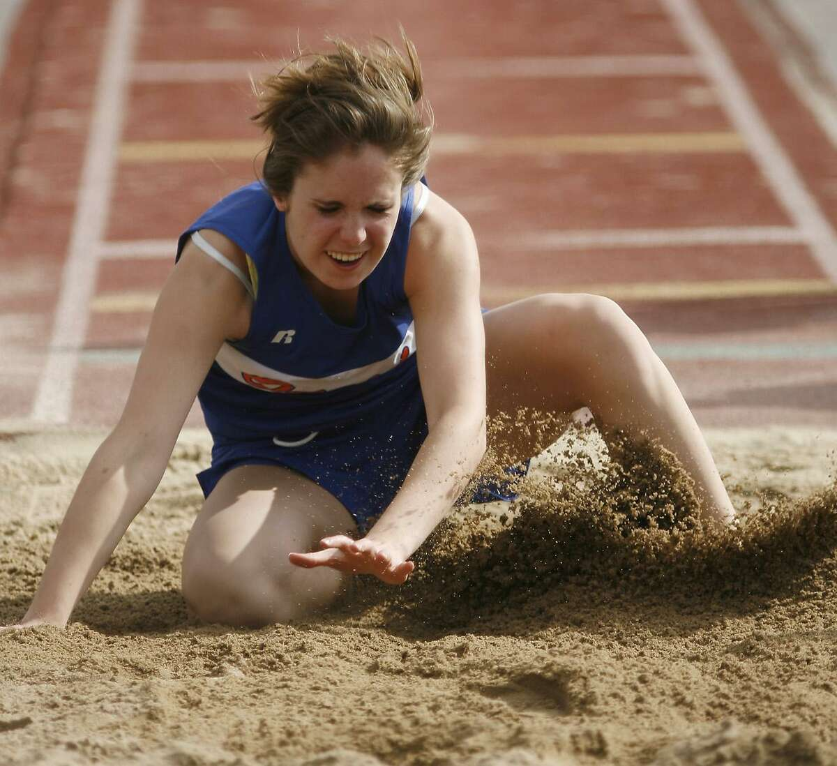 Dispatch Staff Photo by JOHN HAEGER Oneida's Erica Vaccaro lands in the long jump pit during the Oneida Invitational on May 6, 2011 in Oneida.
