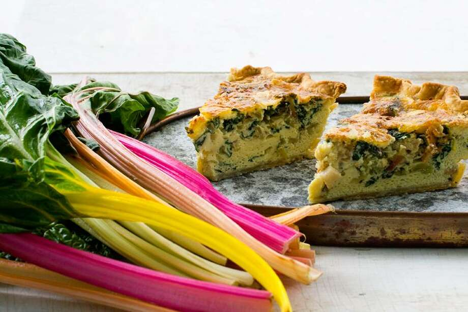 Matthew Mead/Associated Press photo: Rainbow Chard, Bacon and Brie Quiche Photo: AP / AP2011