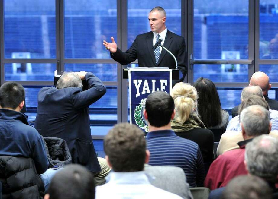 Anthony Reno, new Yale University football coach, answers questions during a press conference announcing his appointment Thursday 1/12/12  at Yale Bowl's Kenney Center Champions Room. Photo by Peter Hvizdak / New Haven Register January 12, 2012       ph2438                 Connecticut